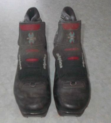 set of cross country ski boots. These boots are a size 8. NNN. In